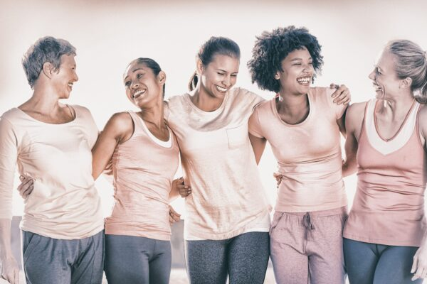 Five women with arms around each other